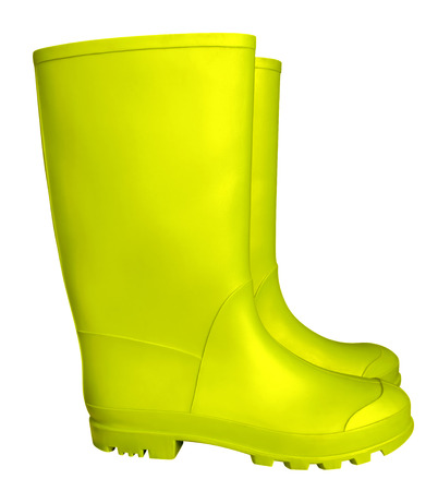 galoshes: Yellow rubber boots isolated on white. Clipping path included. Stock Photo