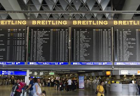 main gate: FRANKFURT AM MAIN, GERMANY - JULY 2, 2015: Travelers at public area at international Frankfurt Airport, the busiest airport in Germany. Longer exposure.