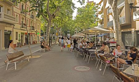 rambla: BARCELONA, SPAIN - JULY 5, 2015: La Rambla Poblenou. Thousands of people walk daily by this popular pedestrian area 1.2 kilometer-long.