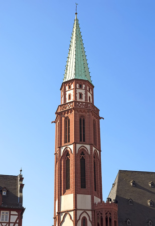 roemer: Belfry of the old Nicolai church in the old town of Frankfurt, Germany. Stock Photo