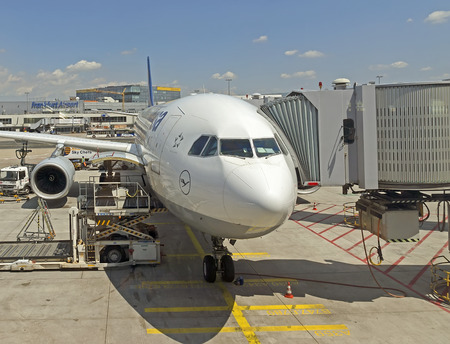 return trip: FRANKFURT AM MAIN, GERMANY - JULY 16, 2015: Passenger airplane front view in Frankfurt am Main. With 38 million passengers per year it is one of the most important airport in Europe.