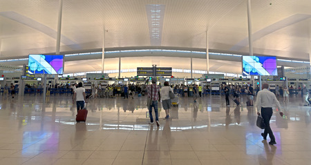 ticketing: BARCELONA, SPAIN - JULY 16, 2015: The public check-in area of Terminal T1 of El Prat-Barcelona airport.
