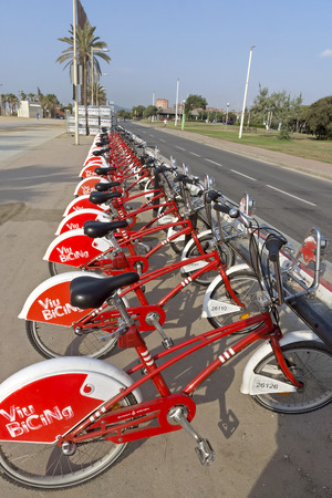 public service: BARCELONA, SPAIN - JULY 12, 2015: Public Service Vehicles bicycles Vodafone Bicing. Bicing is the name of a bicycle sharing system in Barcelona inaugurated on March 22, 2007.