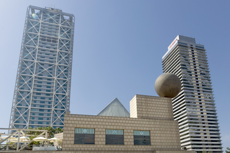 highriser: BARCELONA, SPAIN - JULY 4, 2015: Hotel Arts, built by SOM Group, and Tower Mapfre, build by Ortiz-De Leon, both in 1992 in Barcelona, Spain.