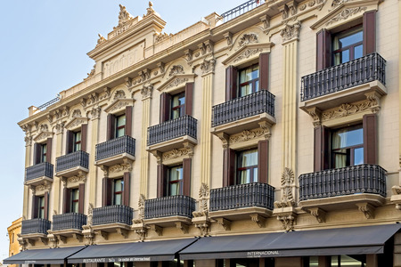 ramblas: BARCELONA, SPAIN - JULY 6, 2015: The International Cool Local Hotel is located in the very heart of Las Ramblas. It was built in 1894. Editorial