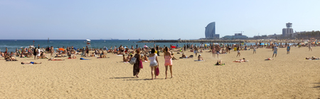 ba�istas: BARCELONA, SPAIN - JULY 4, 2015: A crowd of bathers in La Barceloneta Beach in Barcelona, Spain. This popular beach hosts about 500,000 visitors from everywhere during the summer season.