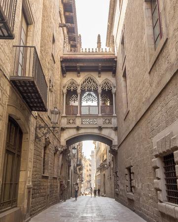 carrer: BARCELONA, SPAIN - JULY 6, 2015: Bridge at Carrer del Bisbe in Barri Gotic, Barcelona. Spain.