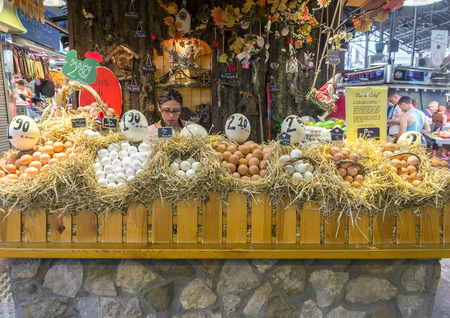 boqueria: BARCELONA, SPAIN - JULY 6, 2015: Trade in eggs, brightly adorned, in the Boqueria market in Barcelona.