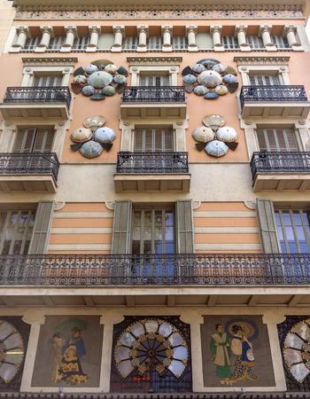 rambla: BARCELONA, SPAIN - JULY 6, 2015: Casa Bruno Cuadros called Umbrella house at La Rambla street in Barcelona, Spain.