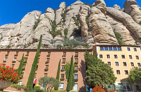 BARCELONA, SPAIN - JULY 10, 2015: Hotel for tourists in the Montserrat mountain near Benedictine abbey Santa Maria de Montserrat high up in the mountains near Barcelona, Catalonia, Spain.