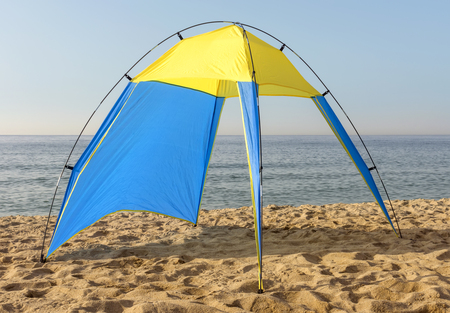 nylon: Blue and yellow nylon tent at the beach. Stock Photo