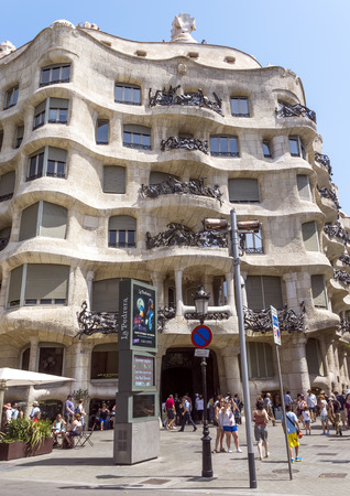 aristocratic: BARCELONA, SPAIN - JULY 6, 2015: Casa Mila (La Pedrera) in Eixample, Barcelona, Spain. Casa Mila, an aristocratic apartment building, is one of Antoni Gaudis most famous works.