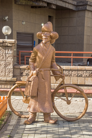 mailmen: ALMATY, KAZAKHSTAN - OCTOBER 20, 2015: The sculpture The Postman in the residential complex Capital Centre. Sculptor Pavel Shorohov, a member of the Union of Artists.