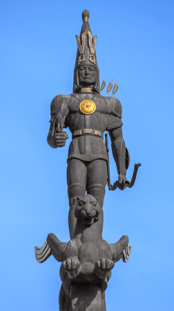 obelisk stone: ALMATY, KAZAKHSTAN - OCTOBER 21, 2015: Sculpture of Golden Warrior on top of the Monument of Independence of Kazakhstan. Monument was inaugurated on Republic Square December 16, 1996.