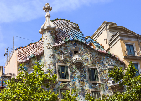 BARCELONA, SPAIN - JULY 6, 2015: Casa Batllo from the street Passeig de Gracia in Barcelona. This house is a famous building of the Antoni Gaudi known for his amazing work especially in Barcelona. Editorial