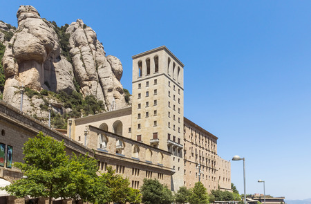 virgin of montserrat: BARCELONA, SPAIN - JULY 10, 2015: The Benedictine abbey Santa Maria de Montserrat in Monistrol de Montserrat, Spain. It hosts the Virgin of Montserrat, the favourite in Catalonia. Editorial