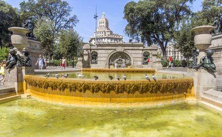 catalunya: BARCELONA, SPAIN - JULY 6, 2015: Fountain at Plaza De Catalunya (Square of Catalonia) in Barcelona. Spain.