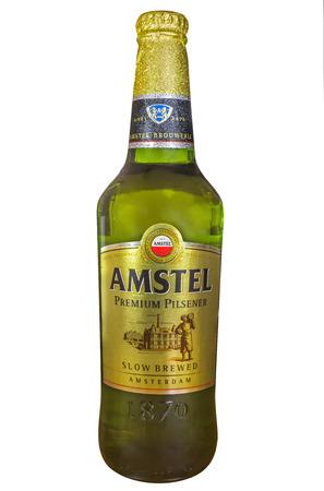 amstel: ALMATY, KAZAKHSTAN - JULY 20, 2015: Bottle of Amstel Premium Pilsener isolated on white. Amstel Premium Pilsener is an internationally known brand of beer produced by Heineken International in Zoeterwoude, Netherlands.