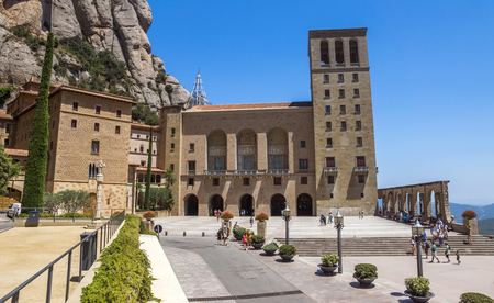 BARCELONA, SPAIN - JULY 10, 2015: The Benedictine abbey Santa Maria de Montserrat in Monistrol de Montserrat, Spain. It hosts the Virgin of Montserrat, the favourite in Catalonia. Editorial