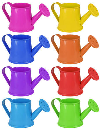 water in can: Colorful watering cans isolated on white background.