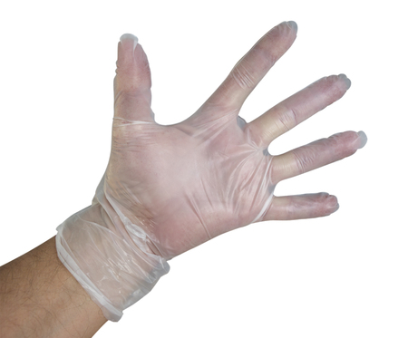 work gloves: Mans hand into disposable plastic glove isolated on white. Clipping path included.