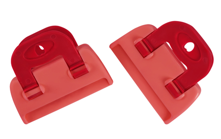 clamps: Red plastic clamps isolated on white background. Clipping path included for your design.