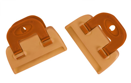 gripe: Orange plastic clamps isolated on white background. Clipping path included for your design. Stock Photo