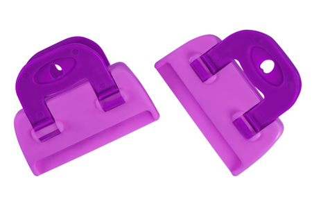 clench: Violet plastic clamps isolated on white background. Clipping path included for your design.