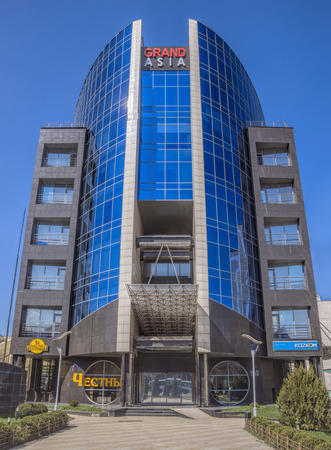 ata: ALMATY, KAZAKHSTAN - MARCH 21, 2016: Business Center Grand Asia is an office building located at Tole bi street in Almaty. Built in 2013.  Almaty, Kazakhstan - Mach 21, 2016: Business Center Grand Asia is an office building located at Tole bi street i Editorial