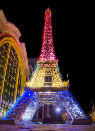 reduced: ALMATY, KAZAKHSTAN - MARCH 23, 2016: Night view of reduced copy of Eiffel Tower on the street Furmanova. Almaty is the largest city in Kazakhstan, and was the countrys capital until 1997. Editorial