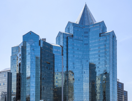 ALMATY, KAZAKHSTAN - JUNE 8, 2016: Business Center Nurly Tau in Almaty, Kazakhstan. Made in the style of Hi-Tech, repeating silhouettes of mountains Zailisky Alatau. Construction company - Basis A. Editorial
