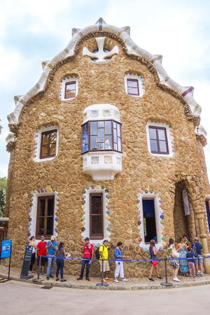 josep: BARCELONA, SPAIN - JULY 3, 2016: Entrance building to the Parc Guell - public garden in Barcelona, designed and built by Guadi and Josep Jujol in 1914.