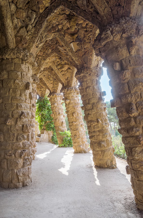 colonnaded: BARCELONA, SPAIN - JULY 3, 2016: Colonnade of park Guell in Barcelona, Spain Editorial