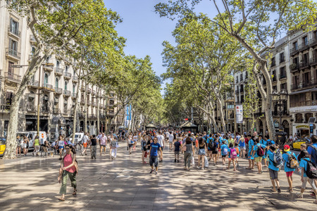 ramblas: BARCELONA, SPAIN - JULY 5, 2016: Hundreds of people promenading in the busiest street of Barcelona, the Ramblas.