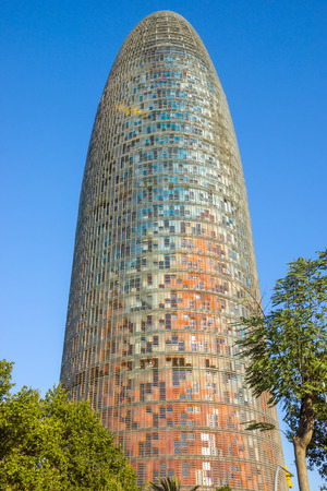 BARCELONA, SPAIN - JULY 10, 2016: The Agbar Tower - is a skyscraper of 38 floors in Barcelona. The tower was designed by architect Jean Nouvel. Editorial