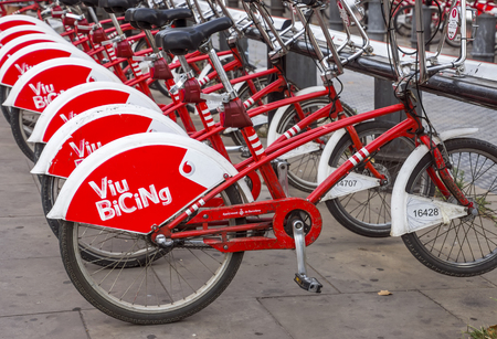 BARCELONA, SPAIN - JULY 11, 2016: Bicycles on a street of Barcelona. Bicing is the name of a bicycle sharing system in Barcelona inaugurated on March 22, 2007. Editorial