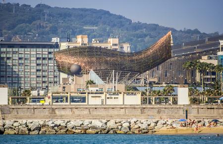 montjuic: BARCELONA, SPAIN - JULY 2, 2016: Frank Gehrys modern El Peix dOr sculpture is located in Barcelonas Vila Olimpica. Editorial