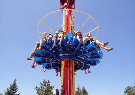 adrenaline: ALMATY, KAZAKHSTAN - AUGUST 2, 2016: The Fantasy Amusement park located in Almaty, Kazakhstan. People ride and get the adrenaline.