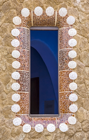 josep: BARCELONA, SPAIN - JULY 3, 2016: Details of building in the Parc Guell - public garden in Barcelona, designed and built by Guadi and Josep Jujol in 1914.