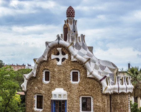 BARCELONA, SPAIN - JULY 3, 2016: Close up of Entrance building in the Parc Guell - public garden in Barcelona, designed and built by Guadi and Josep Jujol in 1914.