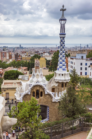 gaudy: BARCELONA, SPAIN - JULY 3, 2016: Park Guell in Barcelona. Park Guell (1914) is the famous architectural town art designed by Antoni Gaudi. Editorial