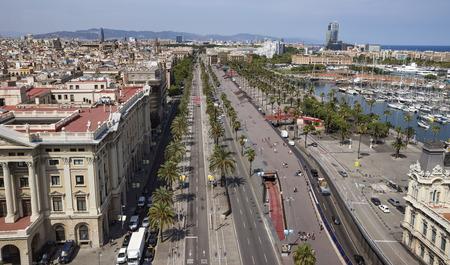colom: BARCELONA, SPAIN - JULY 4, 2016: La Barceloneta and Port Vell marina from Christopher Columbus monument in Barcelona, Catalonia, Spain