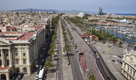 BARCELONA, SPAIN - JULY 4, 2016: La Barceloneta and Port Vell marina from Christopher Columbus monument in Barcelona, Catalonia, Spain