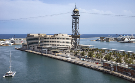 BARCELONA, SPAIN - JULY 4, 2016: View of World Trade Center Barcelona building and Aerial Tramway Torre Jaume of Port Vell