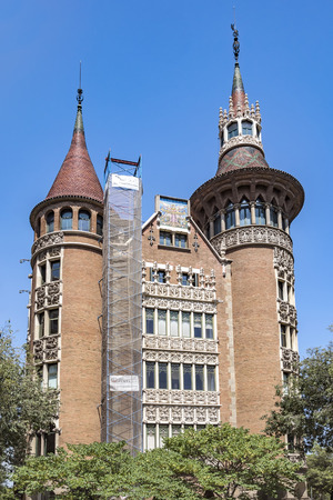 BARCELONA, SPAIN - JULY 5, 2016: Casa de les Punxes (Casa Terrades) on Avinguda Diagonal street. The building in modernism style was built 1902-1905 and designed by Josep Puig i Cadafalch Editorial