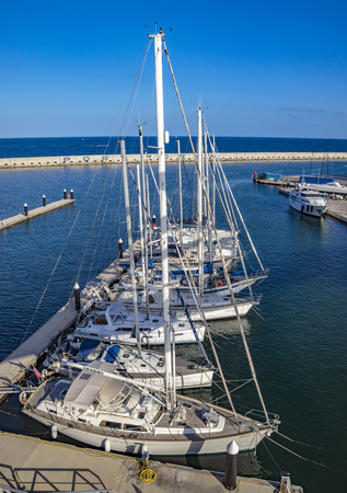 BARCELONA, SPAIN - JULY 3, 2016: The marina Port Forum in the north of Barcelona where lots of ships are moored. Editorial