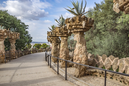 colonnaded: BARCELONA, SPAIN - JULY 3, 2016: Pedestrian road in park Guell in Barcelona, Spain Editorial