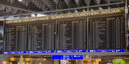 departures board: FRANKFURT AM MAIN, GERMANY - JUNE 30, 2016: Departures board in international Frankfurt Airport, the busiest airport in Germany. In 2012, Frankfurt handled 57.5 million passengers.