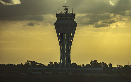control tower: BARCELONA, SPAIN - JULY 14, 2016: The control tower of El Prat-Barcelona airport early morning. This airport was inaugurated in 1963.