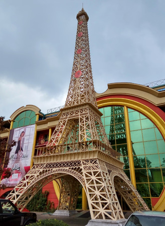 reduced: ALMATY, KAZAKHSTAN - SEPTEMBER 12, 2016: Reduced copy of Eiffel Tower on the street Furmanova. Almaty is the largest city in Kazakhstan, and was the countrys capital until 1997.